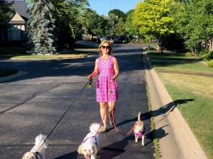 Karen Schmidt walking her dogs