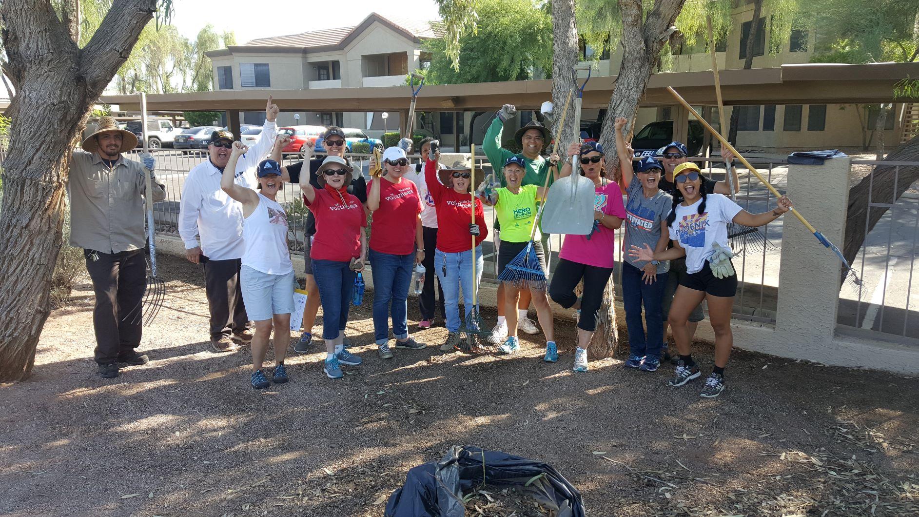 photo of HERO members and staff volunteering in a community garden