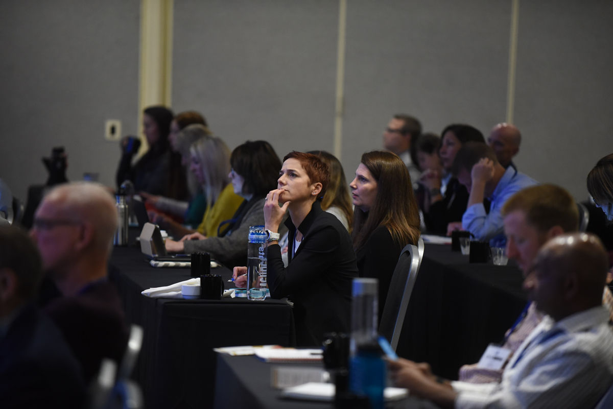 people at HERO Forum conference listening intently