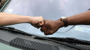fist bump between two races to represent allyship