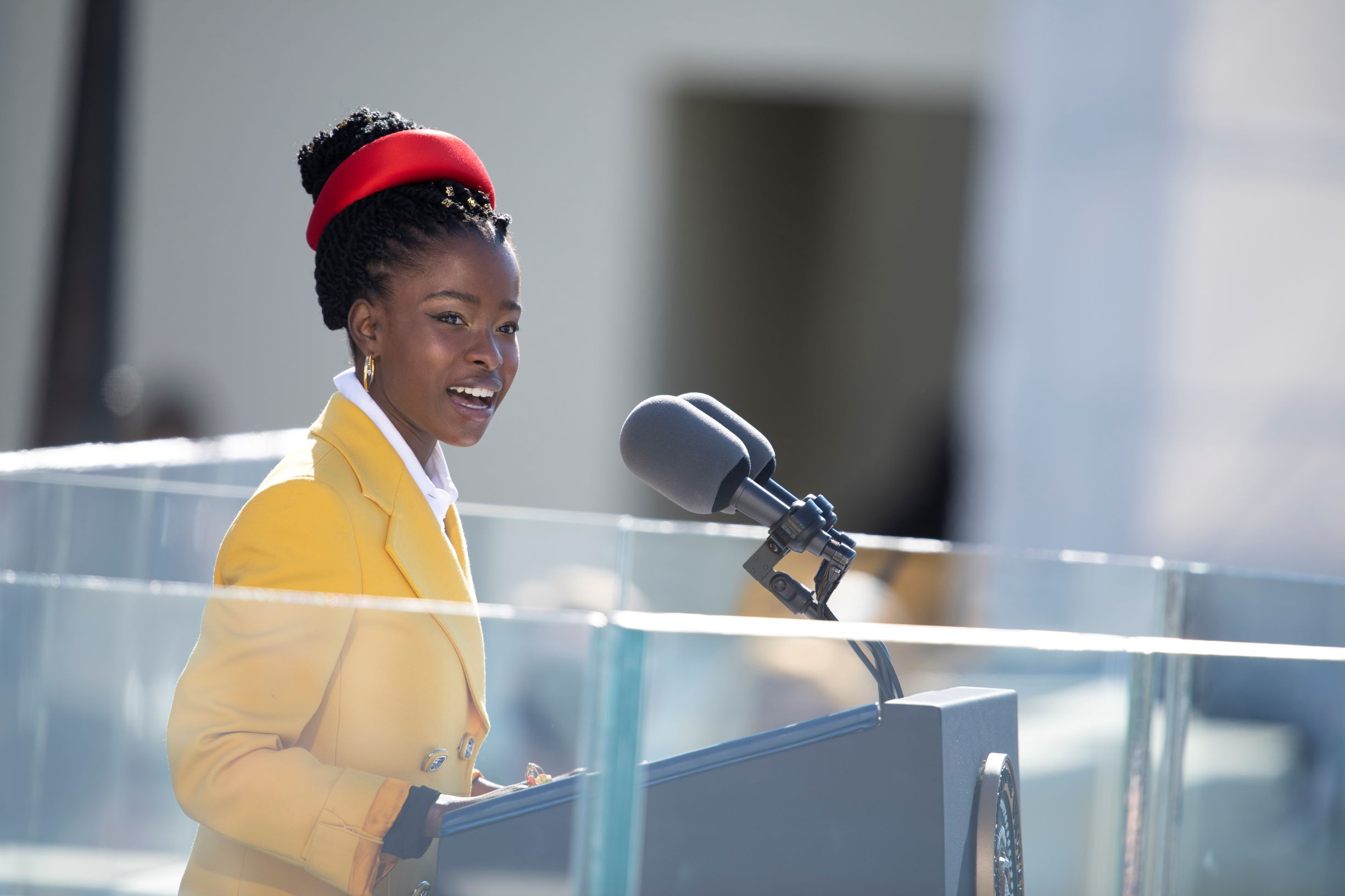 """Amanda Gorman recites her inaugural poem, """"The Hill We Climb,"""" during the 59th Presidential Inauguration ceremony"""